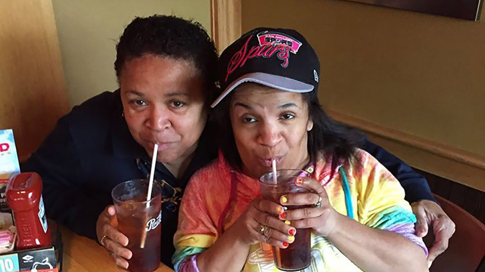 Mother and daughter having sodas