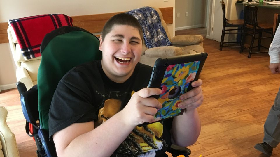 Man enjoying his new electronic at his group home