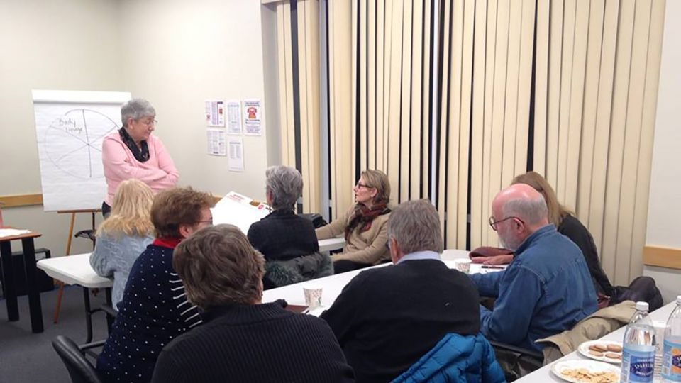Group of people at a family support workshop