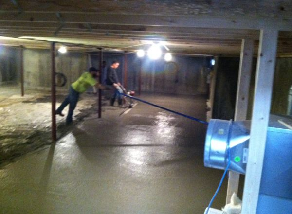 Basement floor being poured.