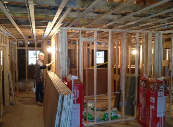 Preparing to install insulation and drywall.