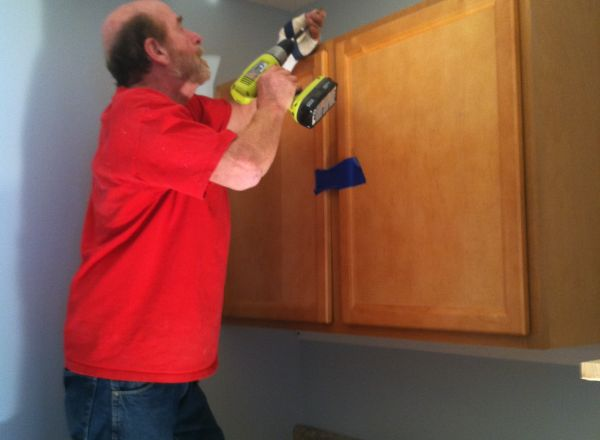 John Smith, Construction Project Manager, puts some final touches on the new group home.