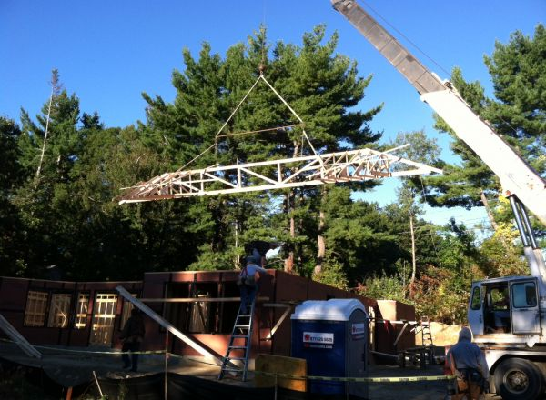 Crane moves trusses into place