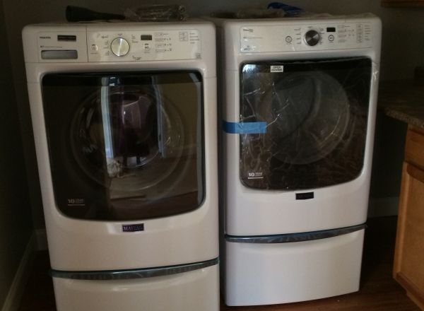 High efficiency washer and dryer located on the ground floor level.