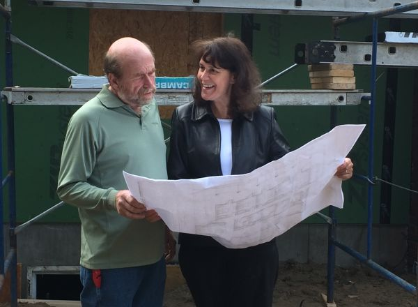 Construction Project Manager, John Smith and Jan from McKenzie Engineering go over the plans at the Auburn home