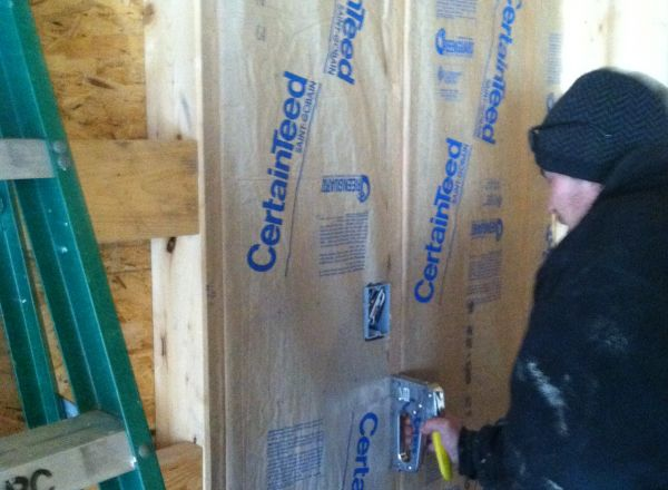 Insulating the new group home.