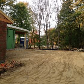 Finish grading around the site.