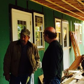 Construction Manager John Smith talks with one of the contractors.