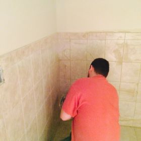 Completing accessible bathroom.