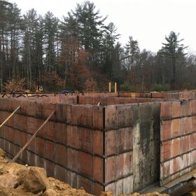 Foundation wall forms completed.