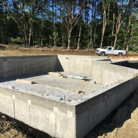 Foundation walls finished and back-filled.