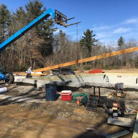 Main support beam being lifted into place.