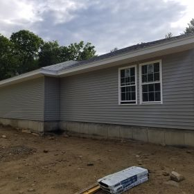 Left Side Siding and Windows Installed