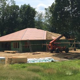 Roof sheathing going on.