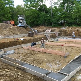 Foundation footings being poured.