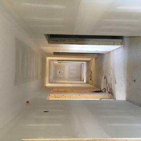 Dry-walled hallway.