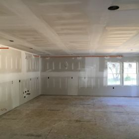 Dry-walled large room.