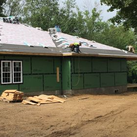 Right side view of roof shingles being installed.